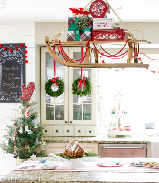 Hang a vintage sled over the kitchen island for a fun Christmas display