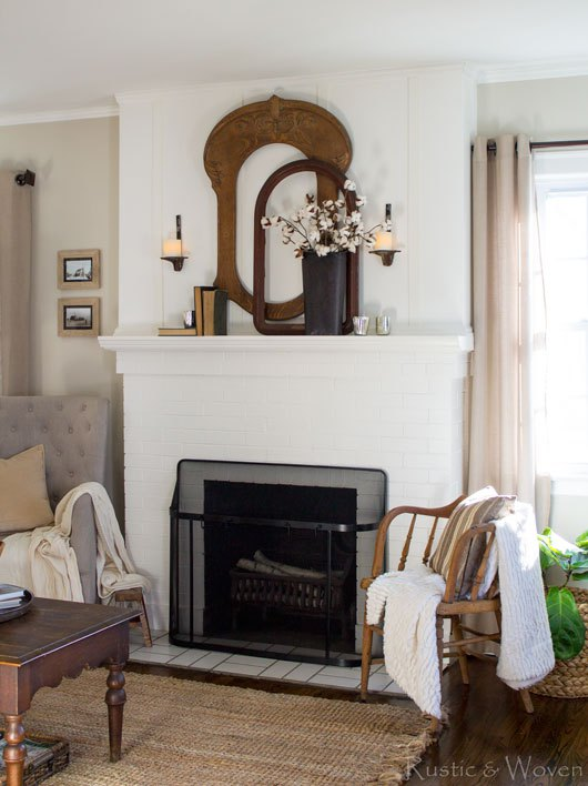 Empty wood frames make a stunning mantel display in this farmhouse living room kellyelko.com