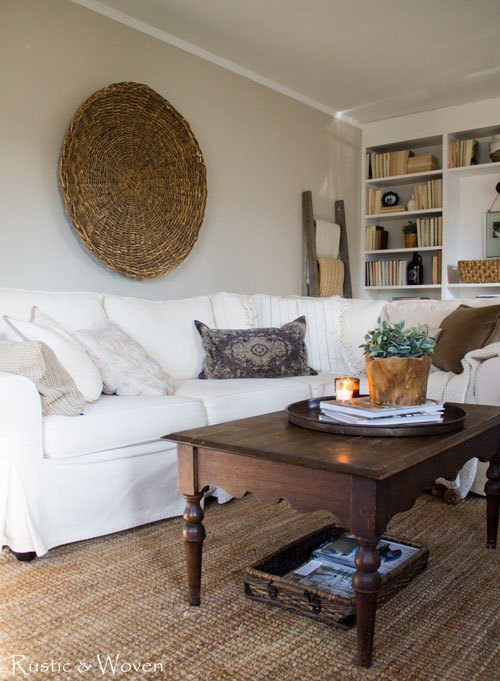 Cozy sectional sofa and huge basket wall art