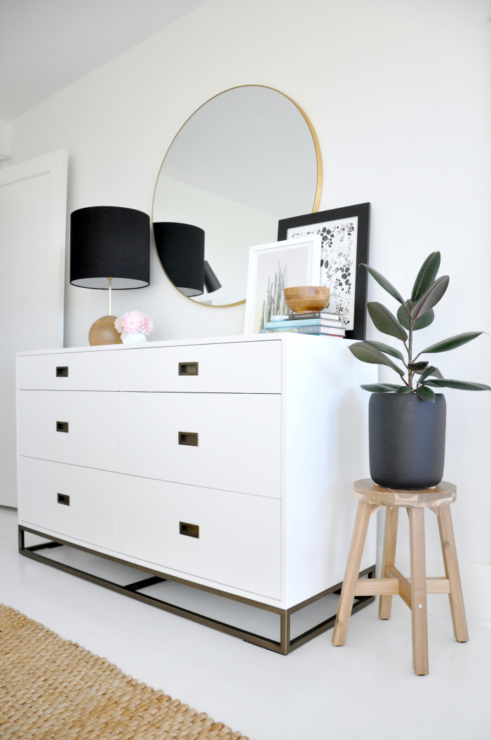 Bedroom dresser with round mirror