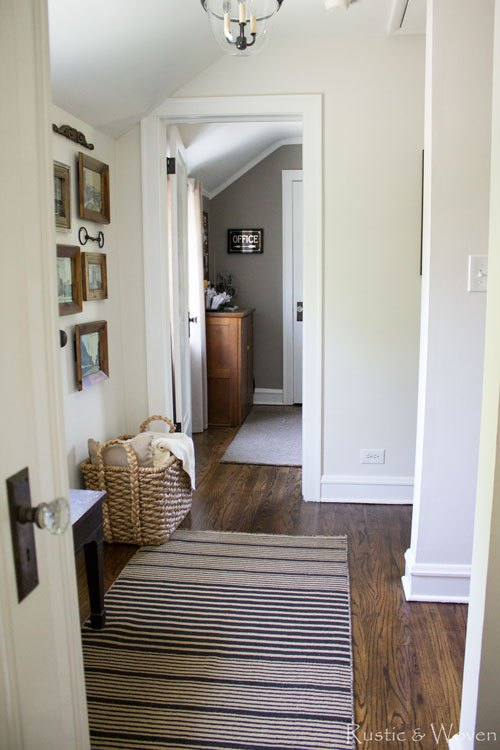 Neutral farmhouse hallway with gallery wall