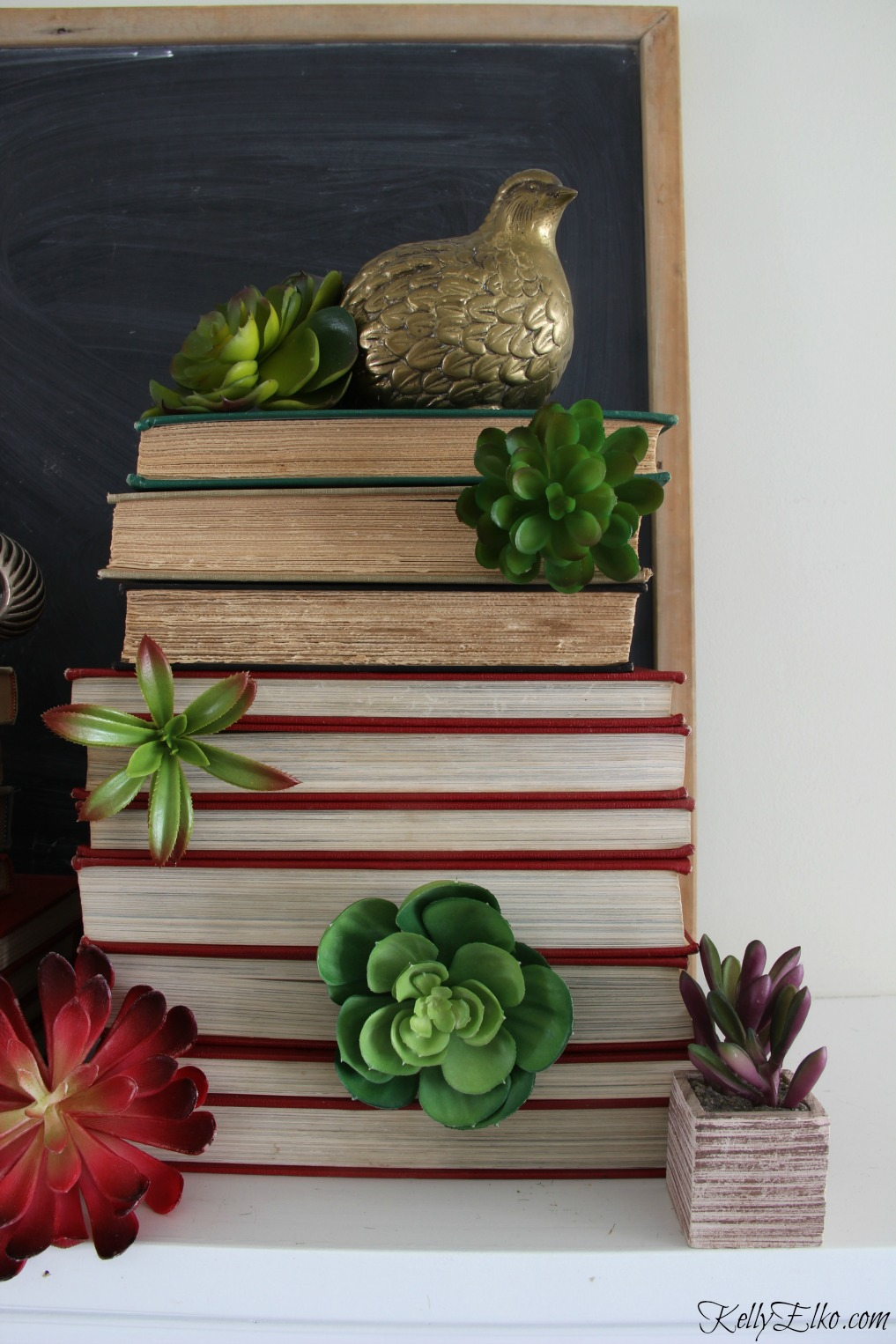 Book tower of succulents - this is a stunning mantel! kellyelko.com