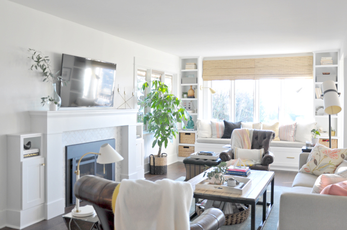 Living room centered around a fireplace - love the built in window seat