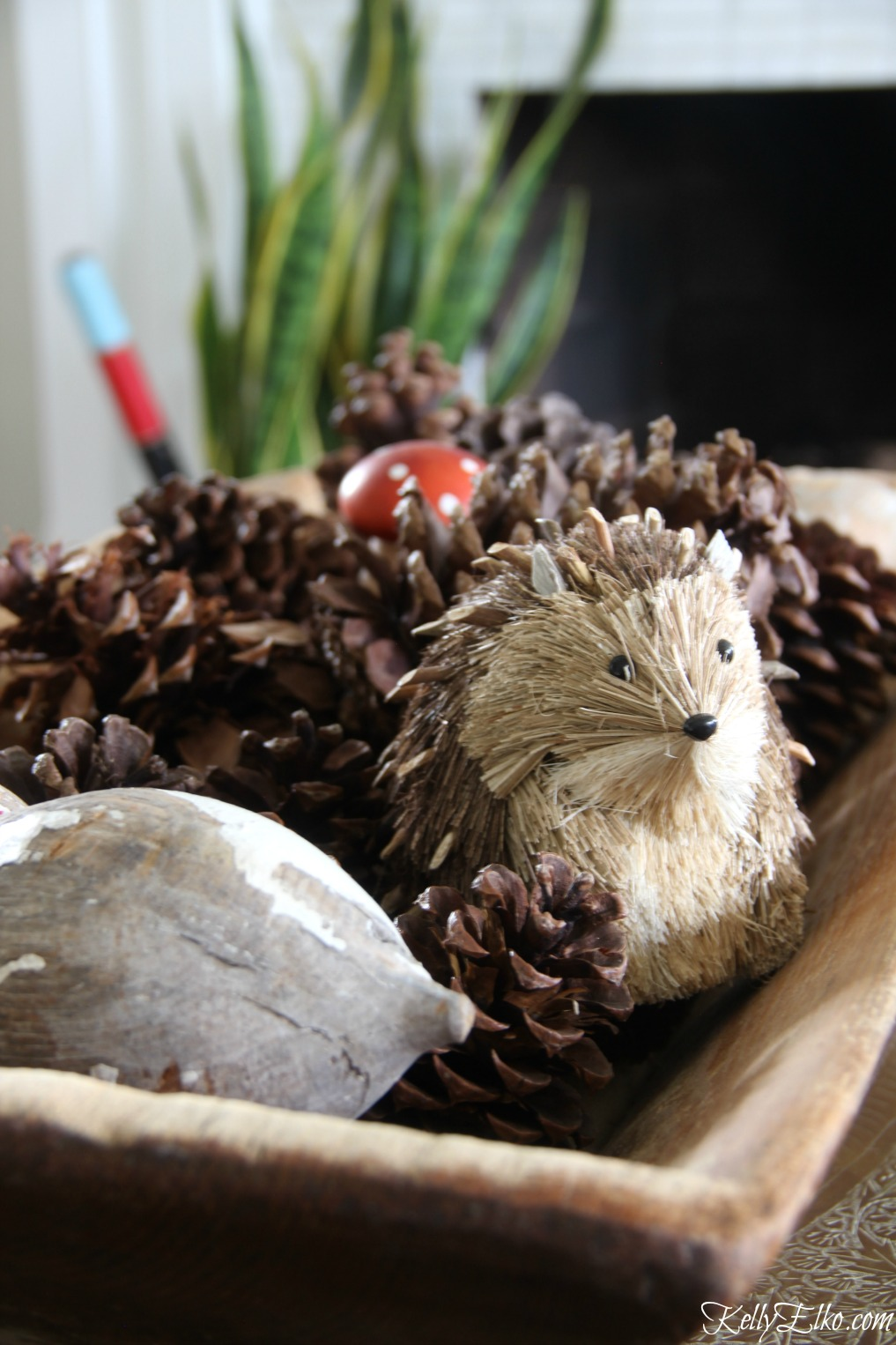 Dough bowl pine cone display - a little critter is a fun touch kellyelko.com