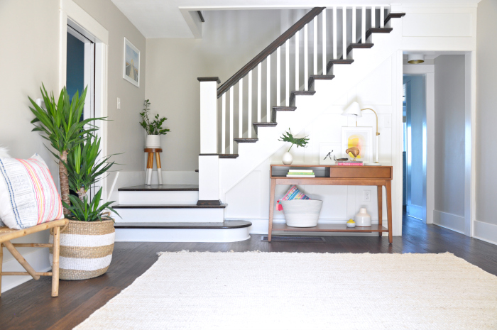 Colorful home tour - love this entryway and staircase kellyelko.com