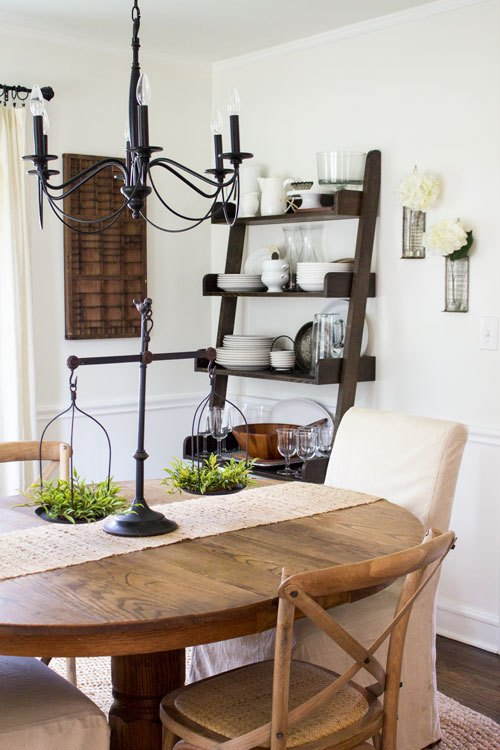Neutral farmhouse dining room with open shelf storage