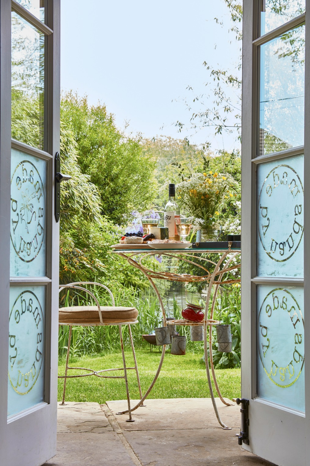 Etched doors spill out onto a beautiful patio kellyelko.com
