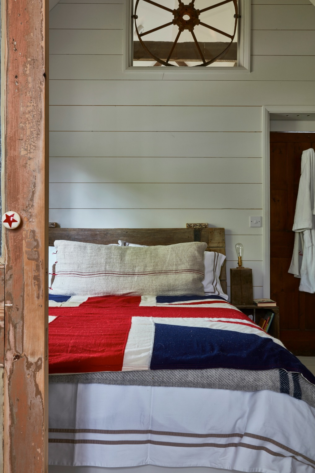 Antique cottage bedroom with planked walls and union jack bedspread kellyelko.com