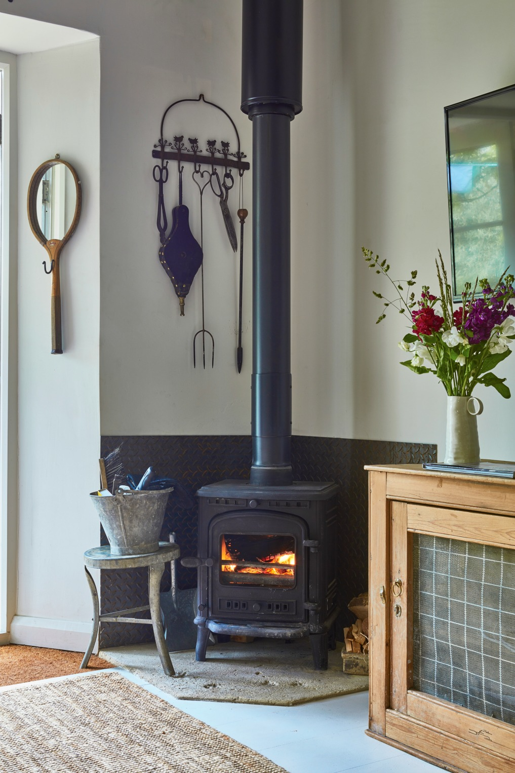 Wood burning stove in this charming cottage kellyelko.com