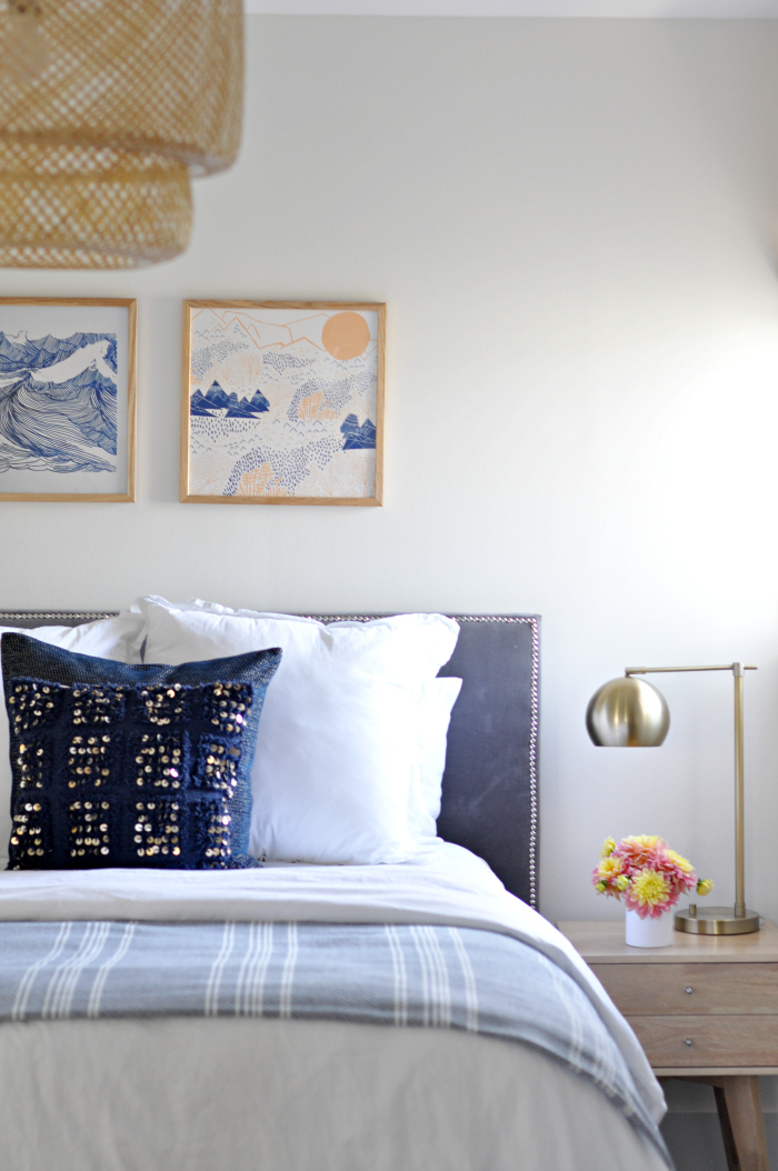 Serene bedroom with blue and brass accents