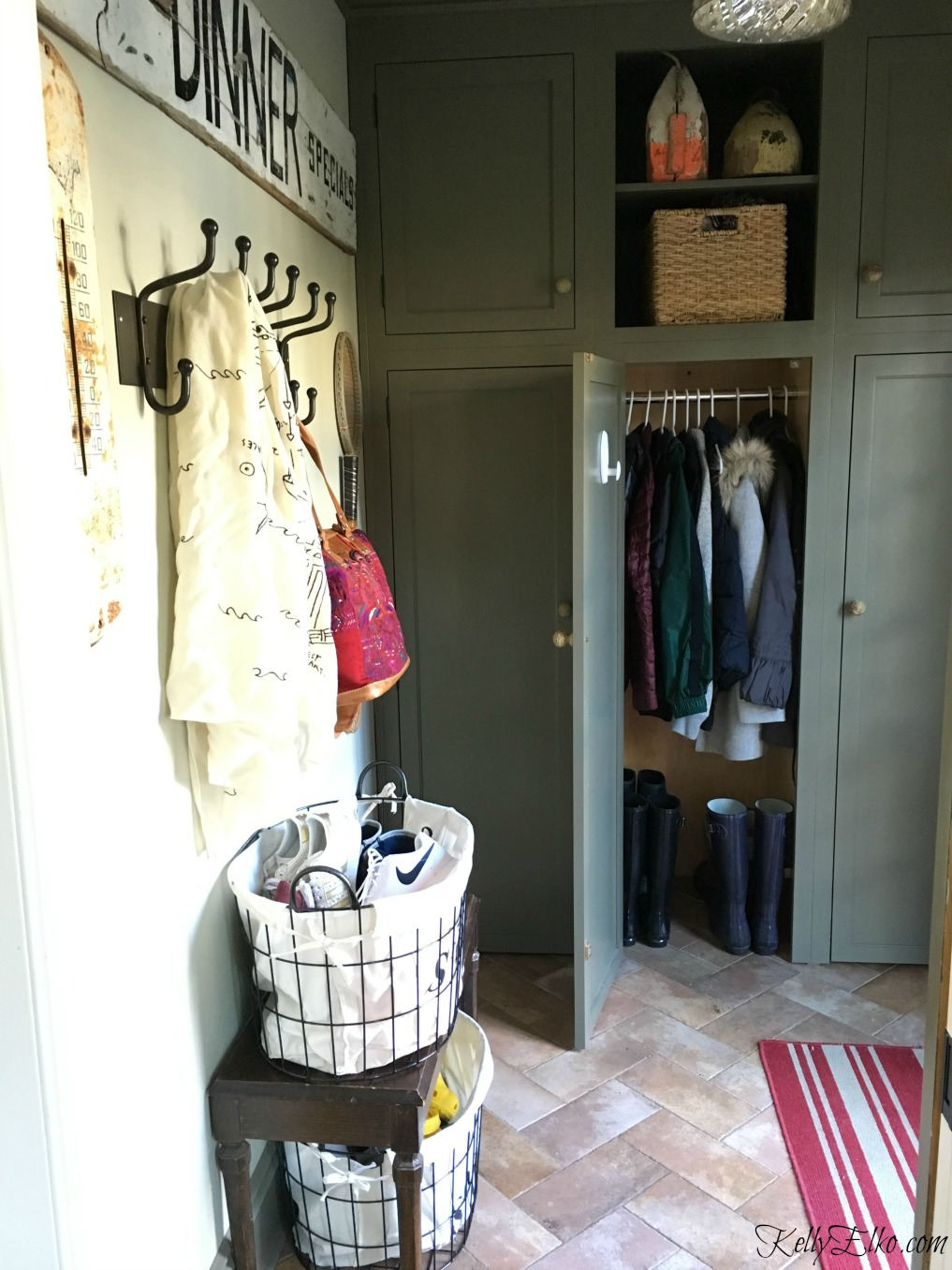 Love this organized mudroom with built in closets kellyelko.com