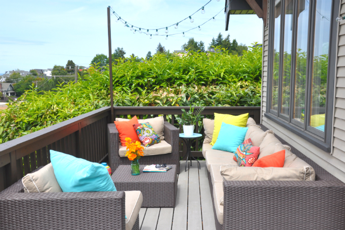 Outdoor deck with modern wicker sofa and chairs