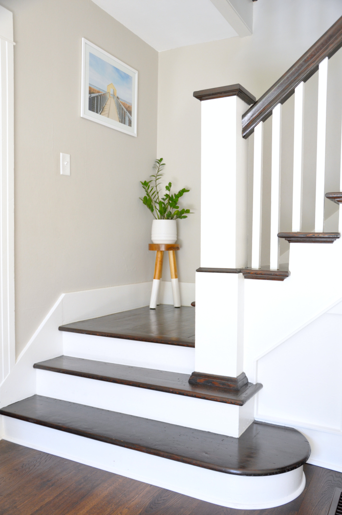 Dark wood stair risers with white railings kellyelko.com