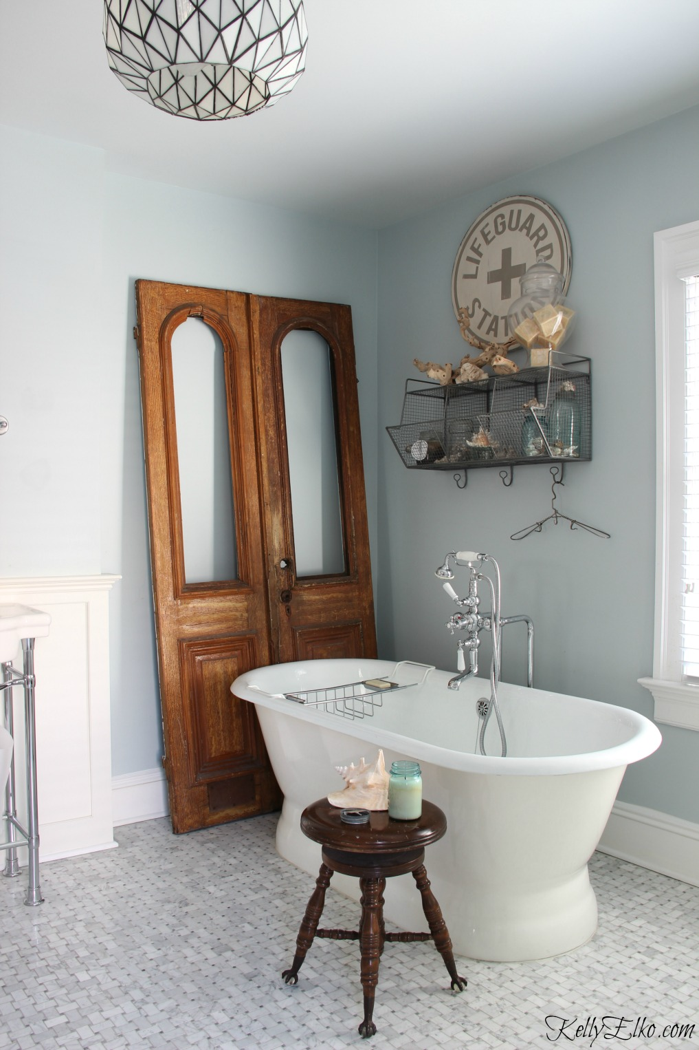Antique arched doors add warmth to a bathroom kellyelko.com