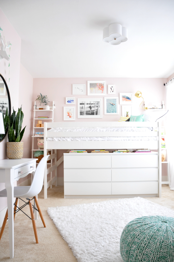 Cute pink girls bedroom with bunk bed and gallery wall