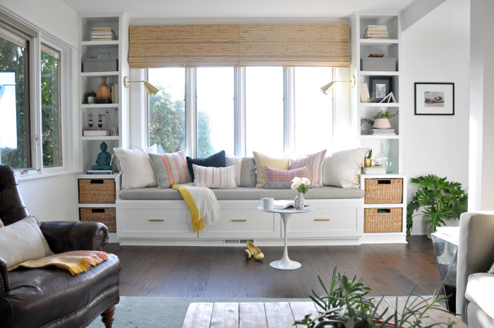 Beautiful built in window seat with bookshelves in this cozy family room