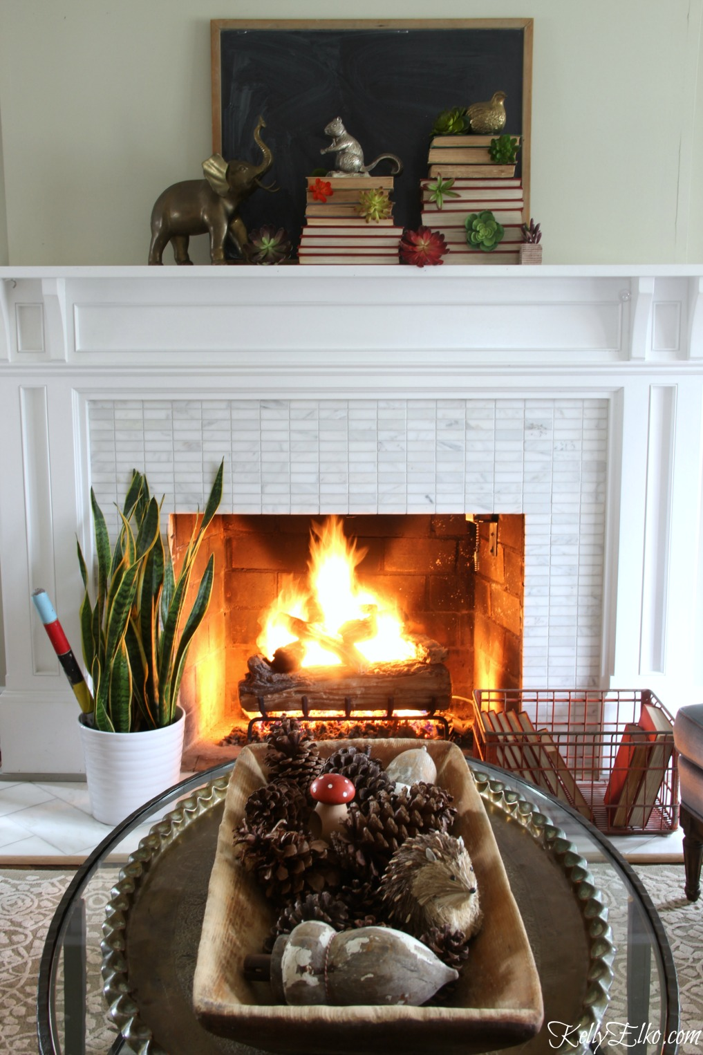 Love this vintage winter mantel with succulents and stacked books kellyelko.com