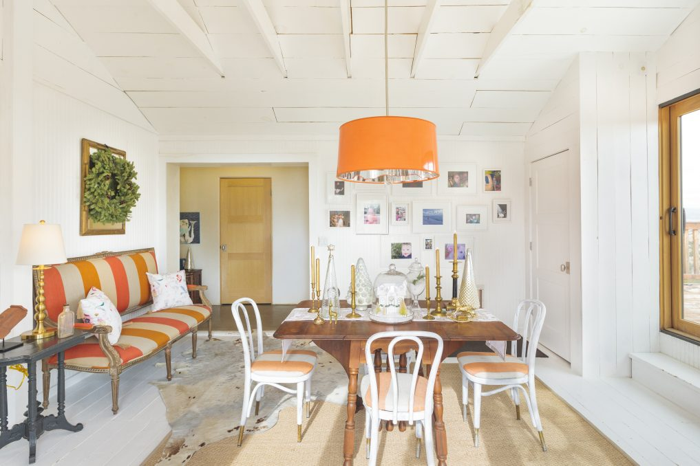 Love this fun, colorful dining room and huge orange chandelier