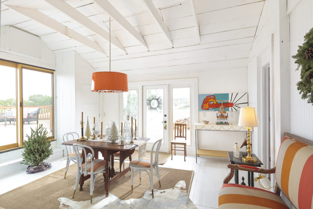 Open and airy dining room with white wood beam ceiling