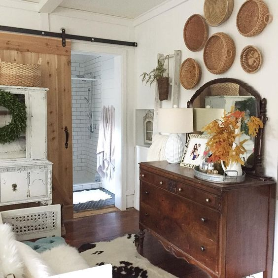 Eclectic Home Tour of Union Willow - love the rolling barn door and the basket gallery wall kellyelko.com