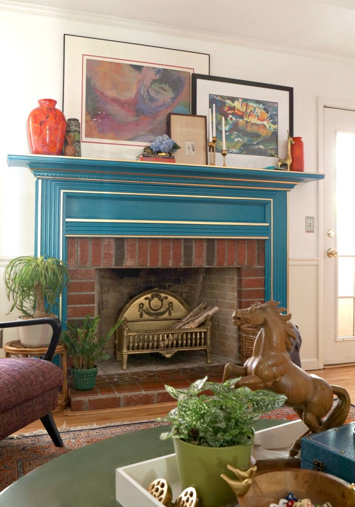 Add a pop of color to a mantel - love the bold blue with gold accents