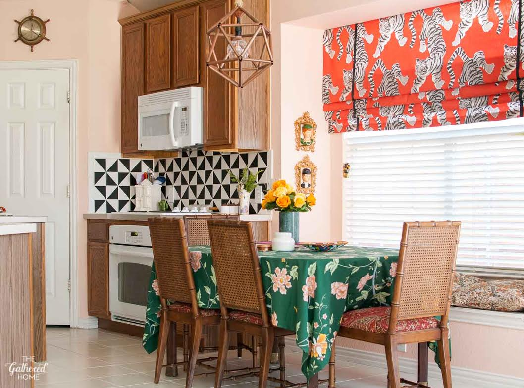 Colorful kitchen - love the tiger fabric roman shade