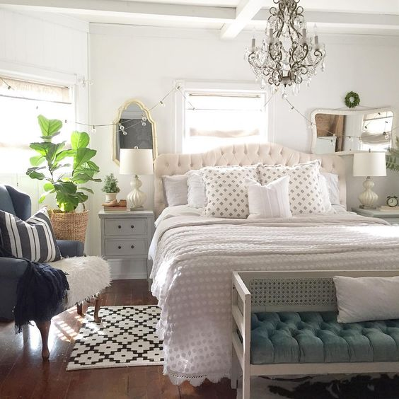 Farmhouse neutral bedroom with crystal chandelier kellyelko.com