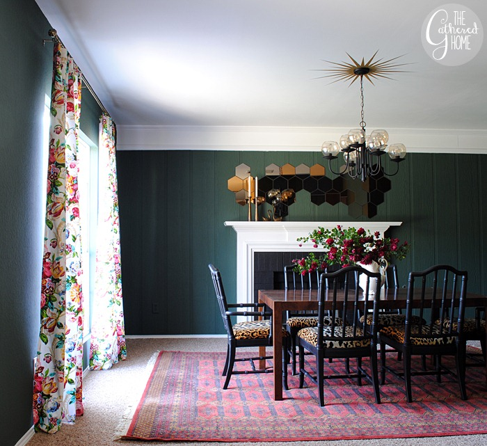 Love this moody green dining room with vintage red rug and floral curtains