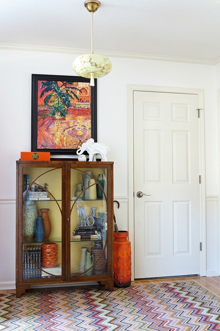 Vintage cabinet with modern art