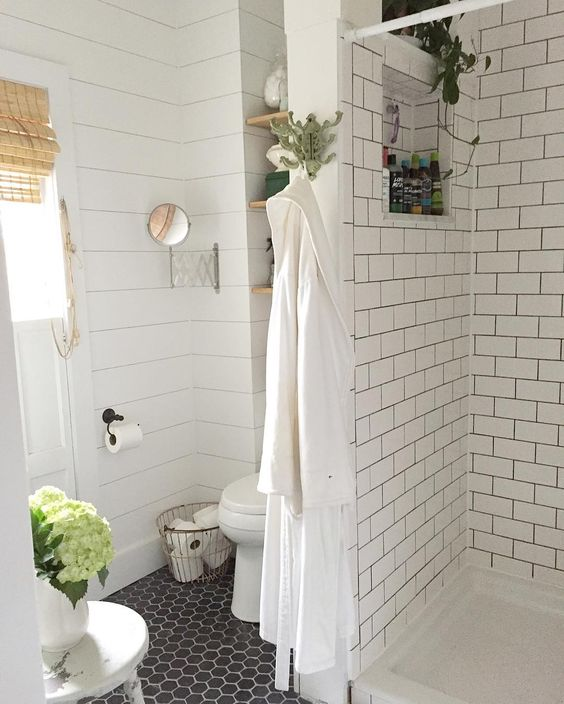 Shiplap and subway tile in a farmhouse bathroom kellyelko.com