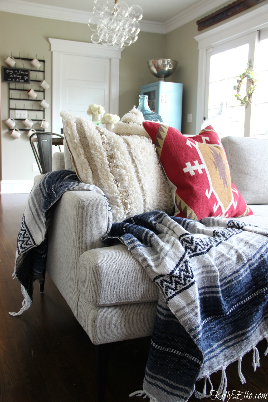 Love this modern sofa with a mix of textiles - Mexican blanket, Moroccan and kilim piillows kellyelko.com