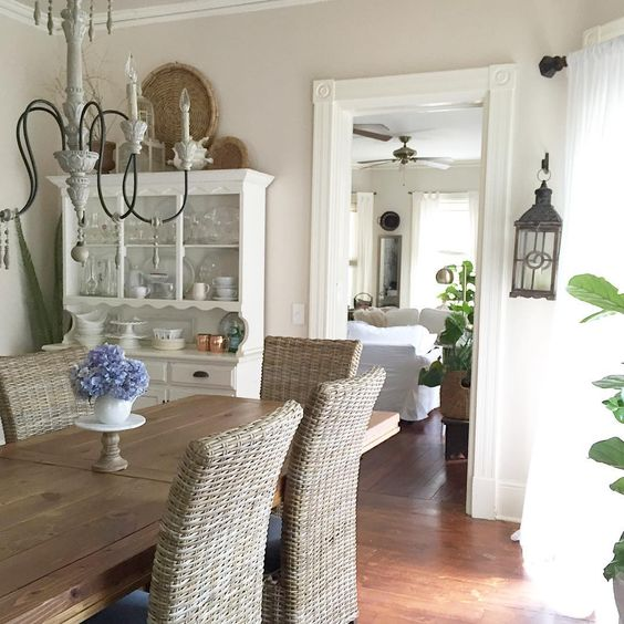 Farmhouse dining room with rustic table and wicker chairs kellyelko.com