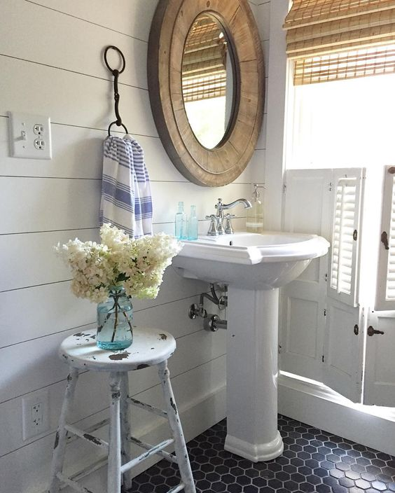 Shiplap walls and black tile in this small farmhouse bathroom kellyelko.com