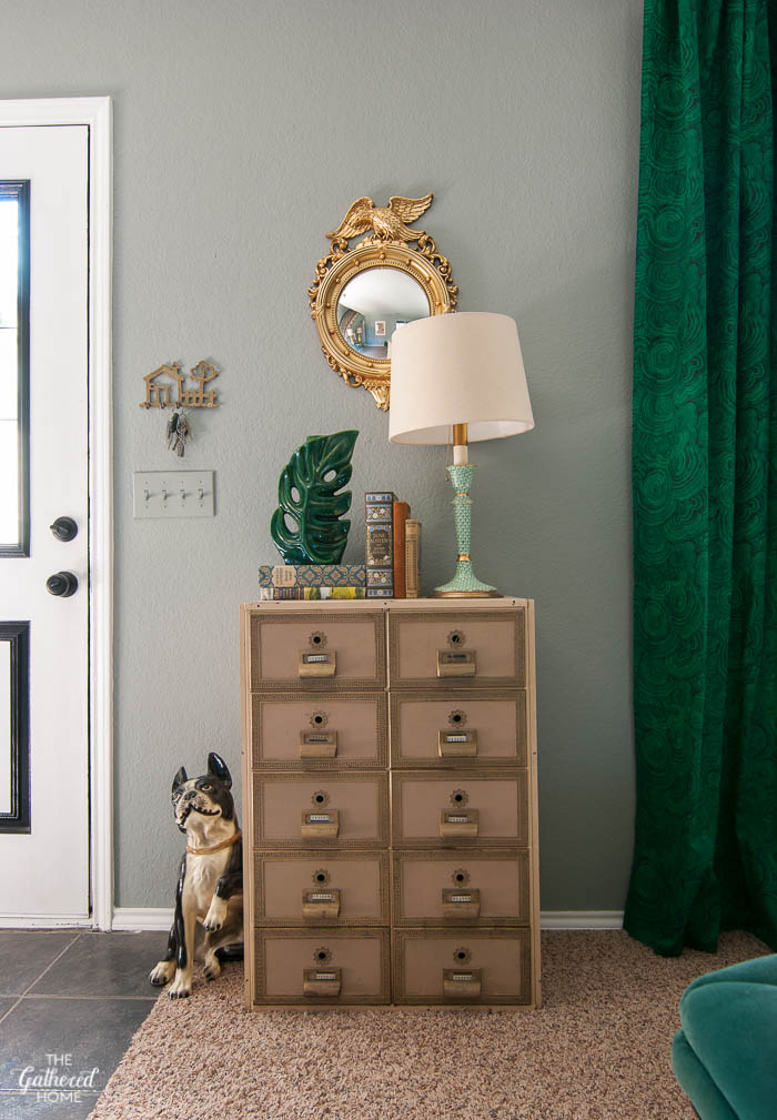 Love this eclectic mix of vintage finds - especially the apothecary cabinet and Boston Terrier sculpture