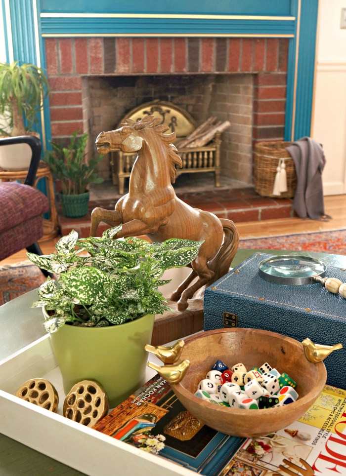 Vintage accessories - love the wood horse and bowl of dice