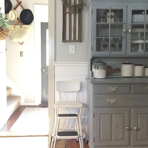 Farmhouse with painted cupboard and vintage step stool kellyelko.com