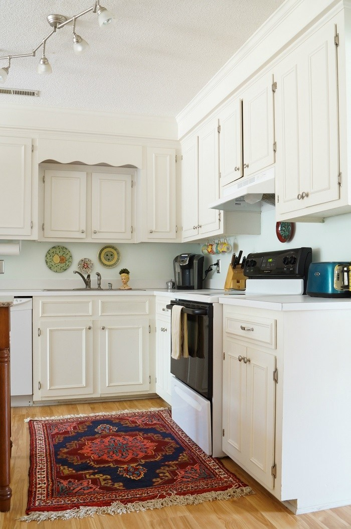 White kitchen with colorful oriental rug