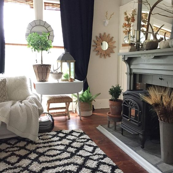 Farmhouse home tour - love the original old mantel painted a deep shade of gray kellyelko.com