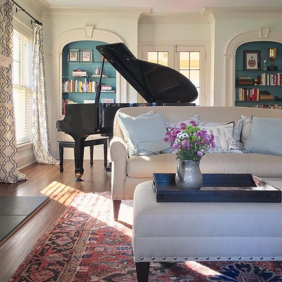 Grand piano in a grand room - love the arched built in bookcases with blue paint kellyelko.com