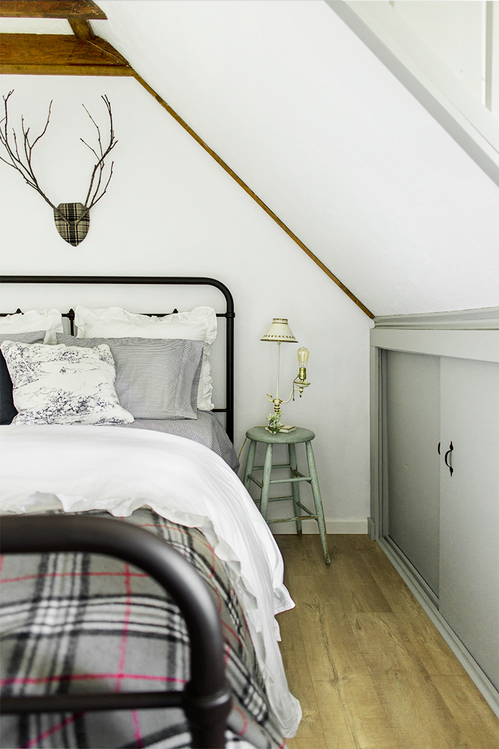 Love the vintage style bed with a little stool as a nightstand