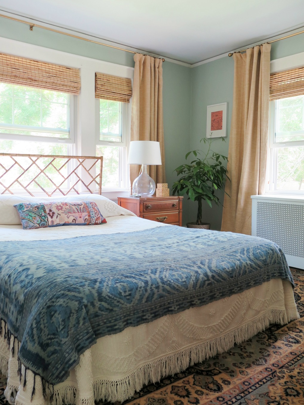 Vintage blue textile adds color to a white bedspread