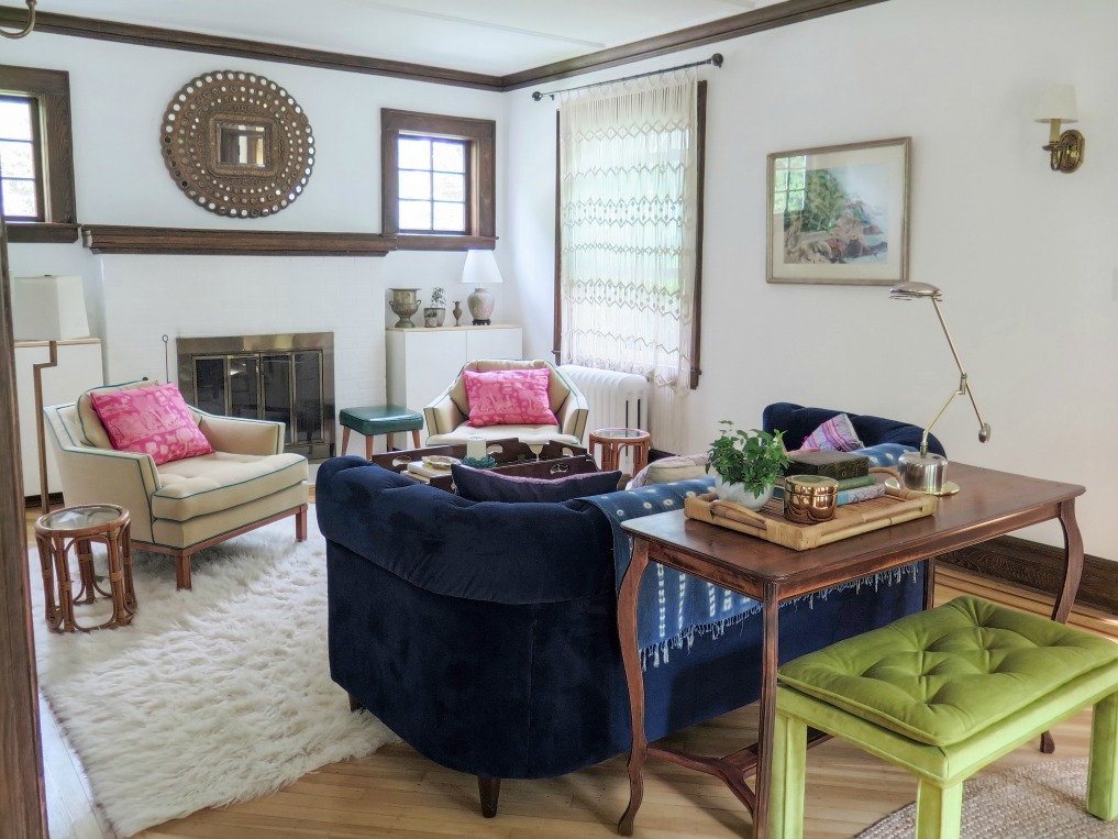 Colorful living room - love the blue velvet Chesterfield sofa and matching club chairs with pops of pink