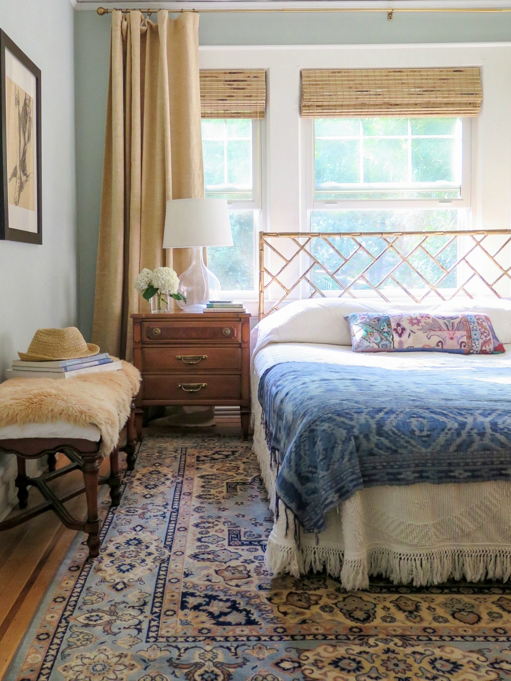 Love this boho bedroom with blue oriental rug, bamboo bed and vintage bedspread