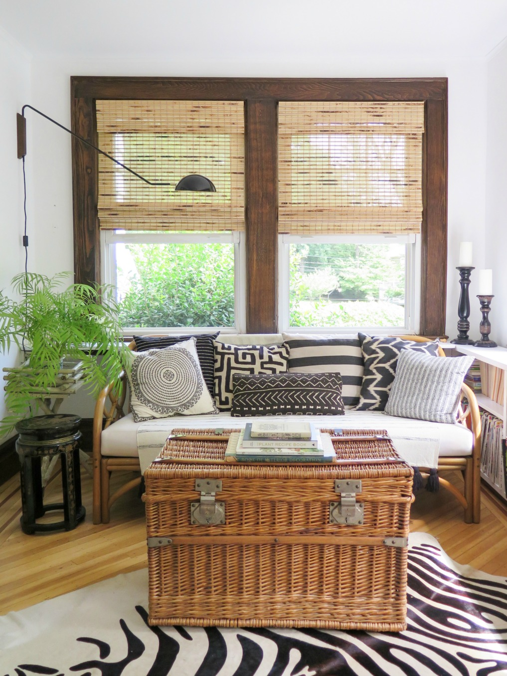 Boho home tour - love this neutral sunroom with texture from rattan, bamboo and lots of plants