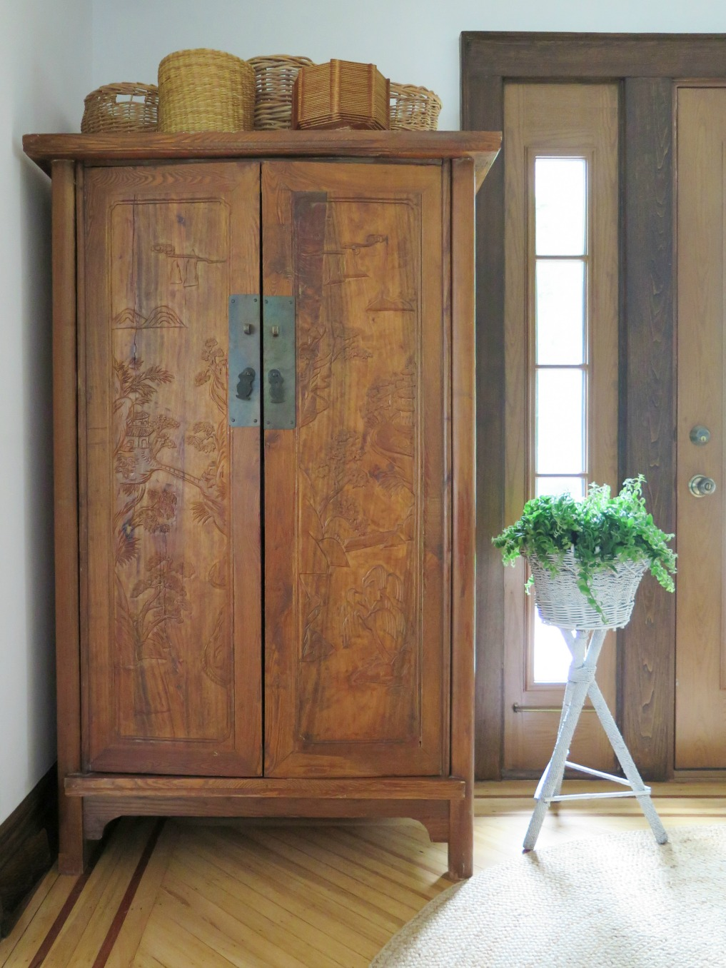 Asian armoire piled with baskets