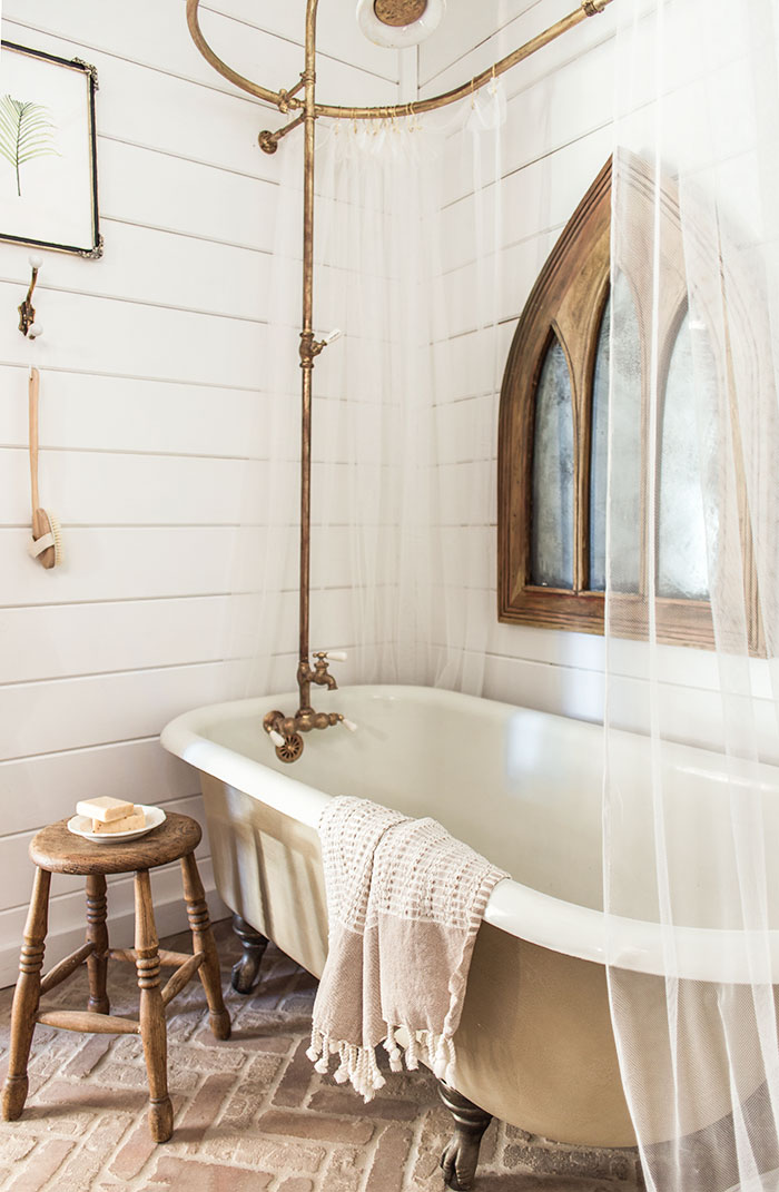 Vintage claw foot bathtub and brass bath fittings give this bathroom a timeless appeal