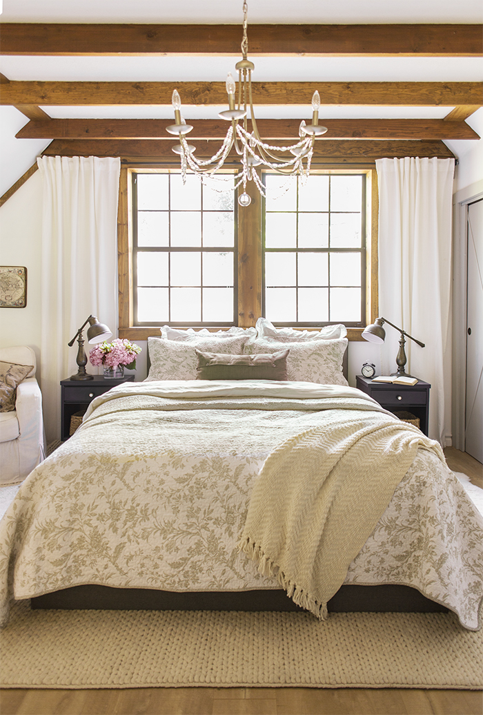 Neutral bedroom with rustic wood ceiling beams