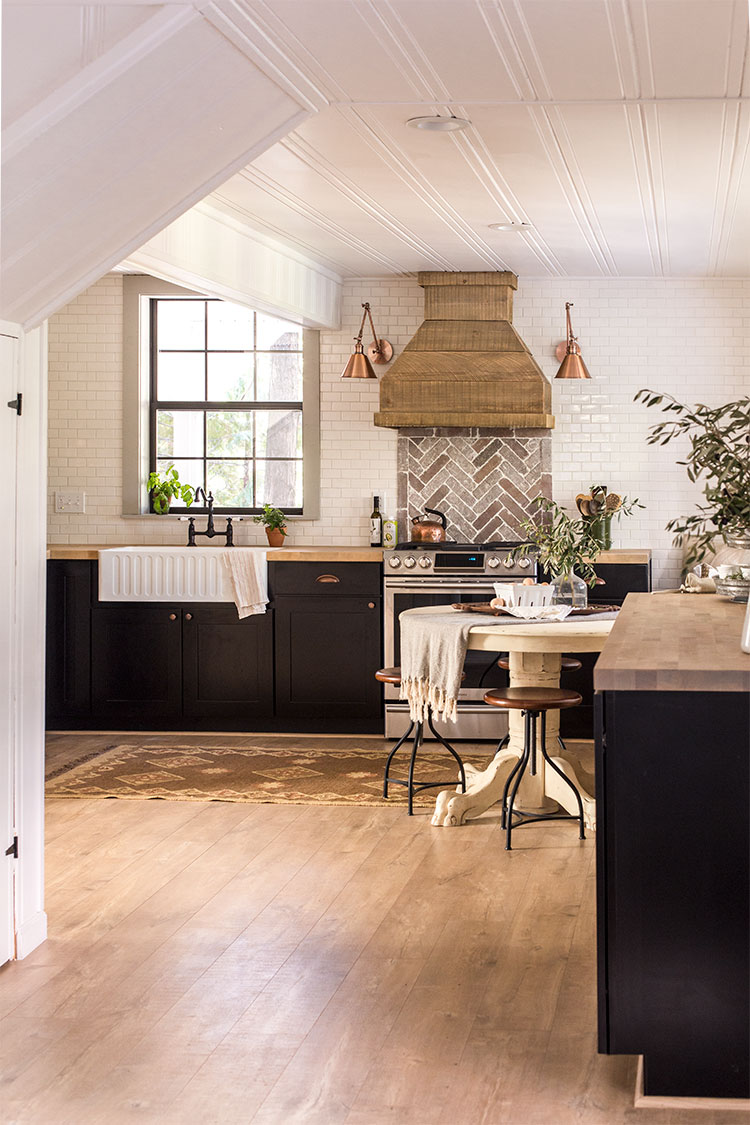 Cottage kitchen tour - love the subway tile mixed with brick backsplash and the gorgeous wood range hood