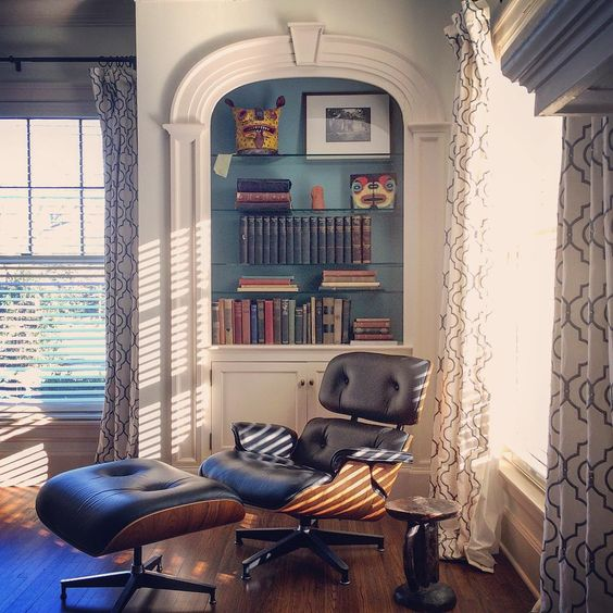 Built in bookcase with blue painted back - love the modern Eames chair kellyelko.com