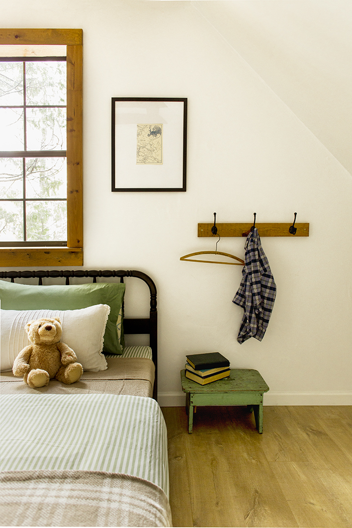 Cute kids bedroom with green step stool for books